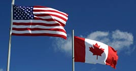 U.S. and Canadian flags on pole
