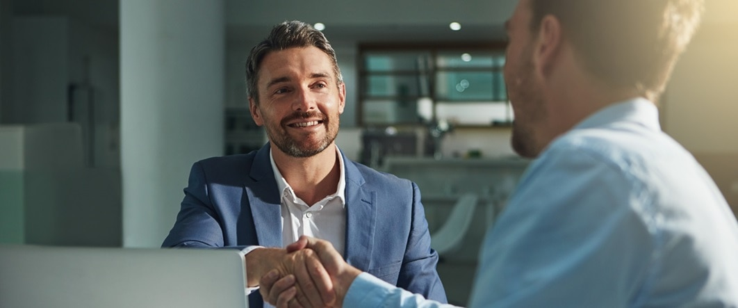 People shaking hands in office