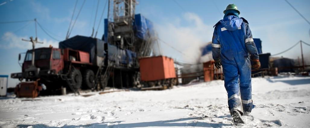 Arctic worker walking towards machinery