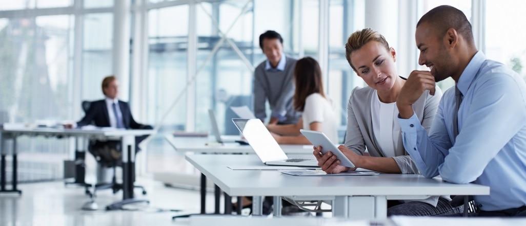 Businesspeople talking in modern office