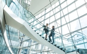 Two professionals talking on a staircase