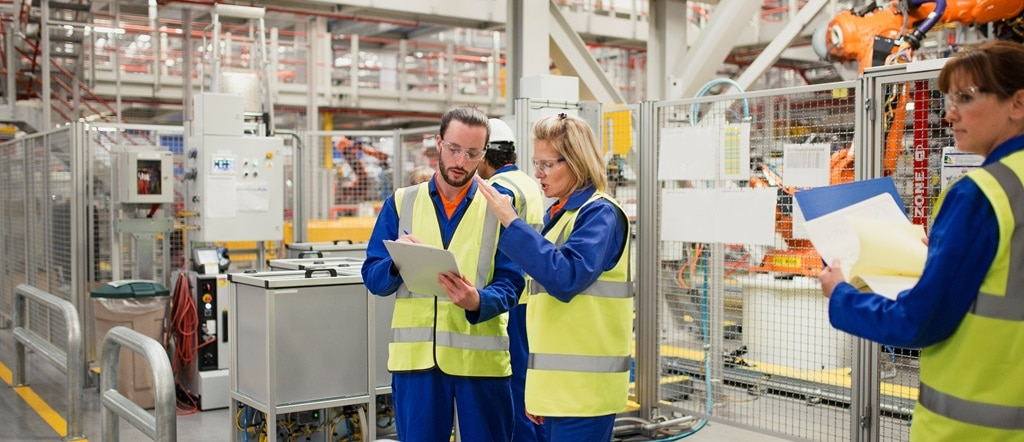 Man and woman in factory performing risk survey